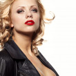 Portrait of a beautiful sexy woman in black leather jacket — Stock Photo