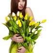Beauty brunette with bunch of flowers — Stok Fotoğraf #9775006