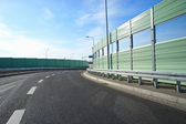 Noise barrier wall on a highway — Stock Photo