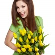 Beauty brunette with bunch of flowers — 图库照片