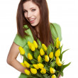 Beauty brunette with bunch of flowers — Foto de Stock