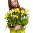Beauty brunette with bunch of flowers — Foto de stock #9783774