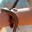 Snake in a girl hand - Stockfoto