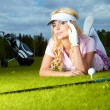 Young blonde  woman with golf equipment — Stock Photo