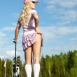 Young blonde  woman with golf equipment - Stock Photo
