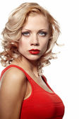 Sexy gorgeous caucasian blonde woman in red dress — Stock Photo