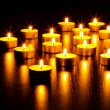 Many burning candles — Stock Photo