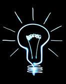 Light bulb isolated on black — Stock Photo