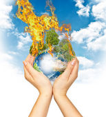 Womanish hands holding burning Earth — Stock Photo