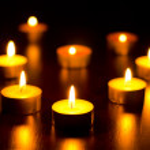 Many burning candles — Stock Photo