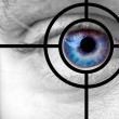 Mans blue eye and target — Stock Photo