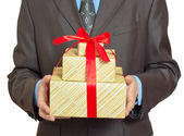Businessman with gift — Stock Photo