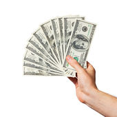 Men's hand holds a fan of dollars — Stock Photo