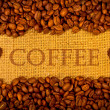 Coffee grains on burlap background — Stock Photo #9549690