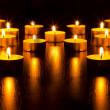Panorama of the many burning candles — Stock Photo
