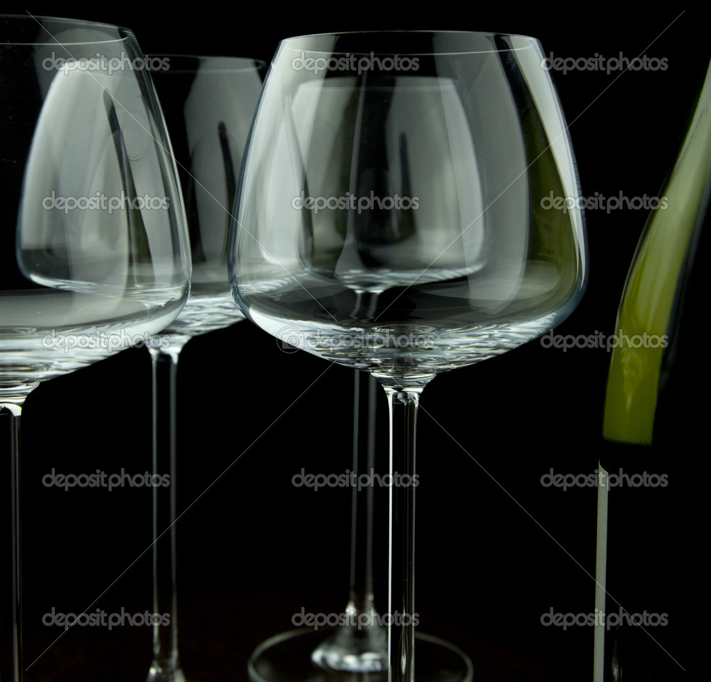 Wine glasses and wine bottle isolated over black background  Stock Photo #8160420