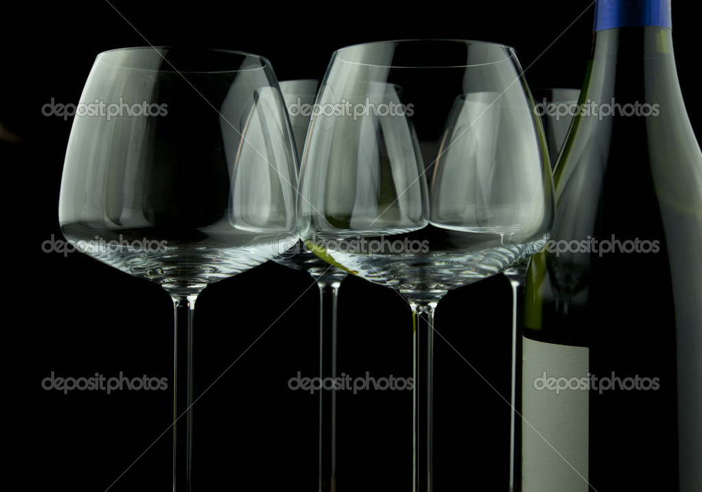 Wine glasses and wine bottle isolated over black background — Stock Photo #8160447