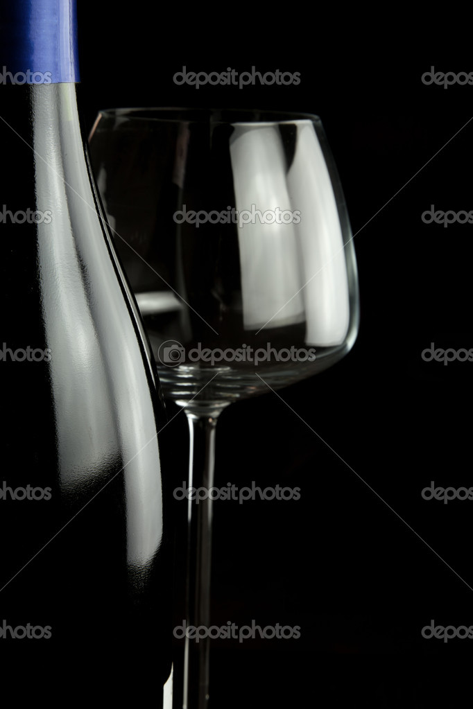 Wine glasses and wine bottle isolated over black background  Stock Photo #8160463