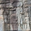 Bas-relief on the wall of Angkor Wat - Stock Photo