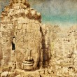 Faces of ancient Bayon Temple At Angkor Wat in retro and grunge - Foto de Stock