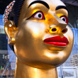 Sculpture of Indian woman's head in Bangkok - Stok fotoğraf