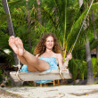 Stock Photo: A woman on a swing