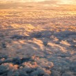 Spectacular view of a sunset above the clouds - Stock Photo