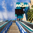 Tourists use an escalator to enter the MGM Grand Hotel - Stock Photo