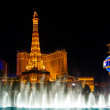 The Musical fountains on Eiffel Tower of Hotel Paris background — Stock Photo