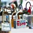 Locks on the fence of the bridge. — Stock Photo