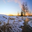 Sunset in winter field — Stock Photo