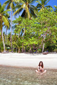 Woman at the tropical beach — Stock Photo