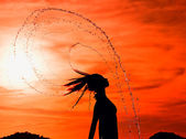 Dancing in the sunset drops — Stock Photo