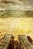 Zwei liegestühle strand — Stockfoto