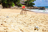 Soccer balls on sand — Stockfoto