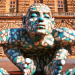 FLORENCE, ITALY - JUNE 28: Abstract puzzling sculpture of man cr - Stockfoto