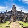 Ancient buddhist khmer temple in Angkor Wat complex - Stock Photo