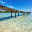 Old wooden pier in the sea — Stock Photo #9661611