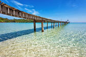 Old wooden pier in the sea — Foto Stock