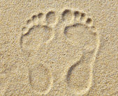 Two Footprints in sand at the Beach — Stock Photo
