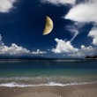 Crescent and many clouds in night sky — Stock Photo
