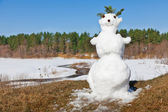 Spring melt snowman — Stock Photo