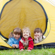 Children in tent - Stock Photo