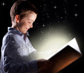 Boy opened a magic book — Stock Photo