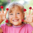 Little girl with raspberry — Stock Photo