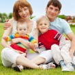 Family in summer park - Stock Photo