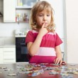 Girl, playing puzzles - Stock Photo