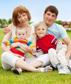 Family in summer park — Stock Photo
