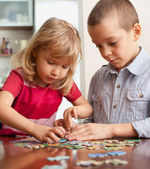 Children, playing puzzles — Stock Photo