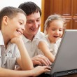 Royalty-Free Stock Photo: Family with laptop